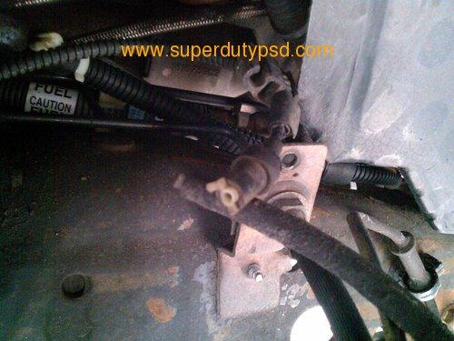 broken Ford white plastic vacuum line fitting